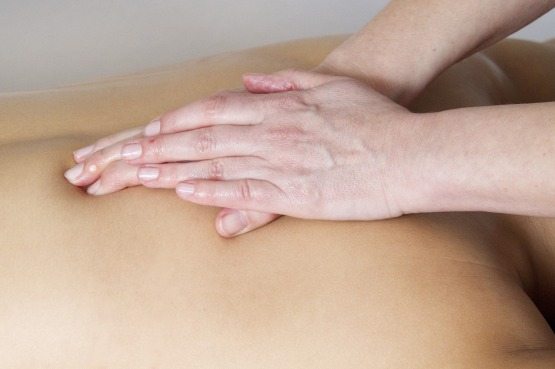 Chiropractor working on someone's back
