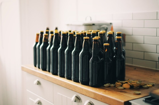 Picture of bottles of beer on a kitchen surface.