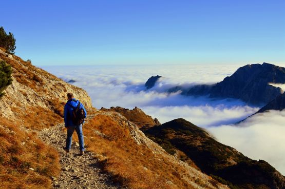 A man walking in the moutains above the clouds