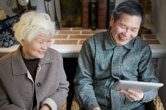 Image of an older couple browsing on an iPad
