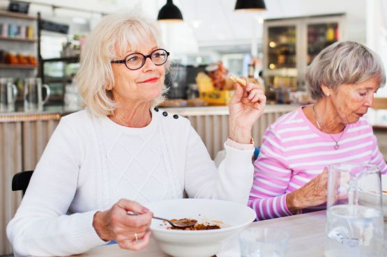 Senior ladies eating lunch in a restaurant