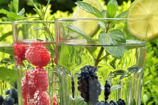 Glasses of water with fruit